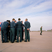 Young air cadets watch returning pilot of the Red Arrows, Britain's RAF aerobatic team during visit to RAF Scampton.