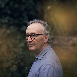 Alain Bertho, an anthropologist, posing at home. Saint-Denis, France. December 14, 2020. <br /> Alain Bertho, anthropologue, prenant la pose, chez lui. Saint-Denis, France. 14 decembre 2020.