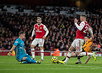 Football - 2019 / 2020 Premier League - Arsenal vs. Wolverhampton Wanderers<br /> <br /> Diogo Jota (Wolverhampton Wanderers) stretches to reach the loose ball as Bernd Leno (Arsenal FC) closes him down at The Emirates Stadium.<br /> <br /> COLORSPORT/DANIEL BEARHAM