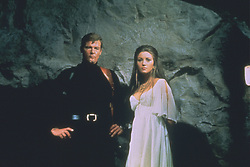 Actor ROGER MOORE stars as James Bond with JANE SEYMOUR as Solitare in 'Live and Let Die.'  (Credit Image: © Entertainment Pictures/Entertainment Pictures/ZUMAPRESS.com)