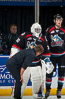 KELOWNA, CANADA - SEPTEMBER 28: Athletic therapist, Scott Hoyer stands on the ice with Michael Herringer #30 of Kelowna Rockets after a collision with a player of the Prince George Cougars on September 28, 2016 at Prospera Place in Kelowna, British Columbia, Canada.  (Photo by Marissa Baecker/Shoot the Breeze)  *** Local Caption *** Scott Hoyer; Michael Herringer;