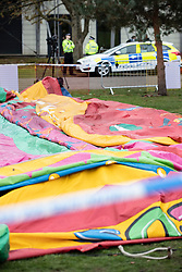 © Licensed to London News Pictures. 04/11/2018. Woking, UK. Police guard the deflated slide as it remains cordoned off in Woking Park after it collapsed injuring eight children. The park was holding a fireworks party when the accident happened. Photo credit: Peter Macdiarmid/LNP