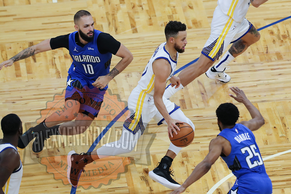 ORLANDO, FL - FEBRUARY 19:  Stephen Curry #30 of the Golden State Warriors drives past Evan Fournier #10 of the Orlando Magic during the first half at Amway Center on February 19, 2021 in Orlando, Florida. NOTE TO USER: User expressly acknowledges and agrees that, by downloading and or using this photograph, User is consenting to the terms and conditions of the Getty Images License Agreement. (Photo by Alex Menendez/Getty Images)*** Local Caption *** Stephen Curry;  Evan Fournier