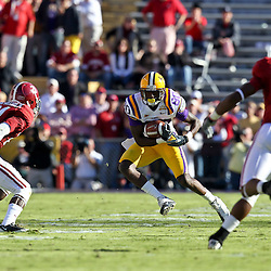 November 6, 2010; Baton Rouge, LA, USA; LSU Tigers wide receiver Terrence Toliver (80) is pursued by Alabama Crimson Tide cornerback Dre Kirkpatrick (21) and cornerback Robert Lester (37) on a play during the first half against the Alabama Crimson Tide at Tiger Stadium. LSU defeated Alabama 24-21.  Mandatory Credit: Derick E. Hingle