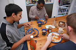 Youths eating a meal,