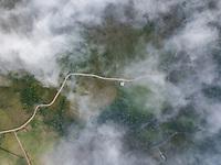 Aerial misty view of long road in Bajos del Toro area, Costa Rica.