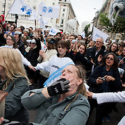 The crowd cheer Aurora's roar. The giant polar bear puppet Aurora made by Greenpeace walked the streets of London in defence of the Arctic as part of a Greenpeace global day of action. The parade,part performance part protest, was to highlight the melting ice caps and the increasing and potentially devastating oil drilling in the arctic sea. Shell is one of the companies drilling and the march through London ended up outside Shell London HQ to draw attention to their oil business in the arctic. Aurora, the biggest polar bear in the world represents all endangered species in arctic.