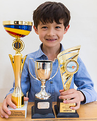 Josh poses with his trophies. Brothers Reuben and Josh Moisey are top level Scrabble Champions with 11 year-old Reuben crowned European Youth Scrabble Champion and 8 year-old Josh became World Under Eight Scrabble Champion in Dubai in 2018. London, August 15 2019.