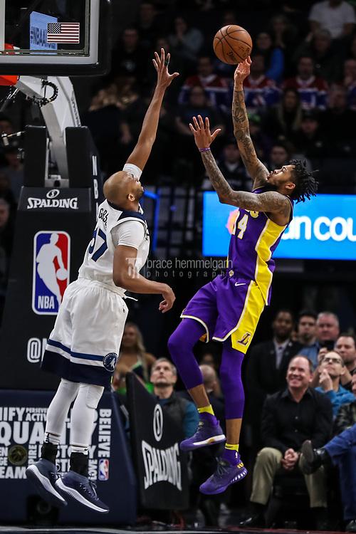 Feb 15, 2018; Minneapolis, MN, USA; Los Angeles Lakers forward Brandon Ingram (14) shoots over Minnesota Timberwolves forward Taj Gibson (67) during the fourth quarter at Target Center. Mandatory Credit: Brace Hemmelgarn-USA TODAY Sports