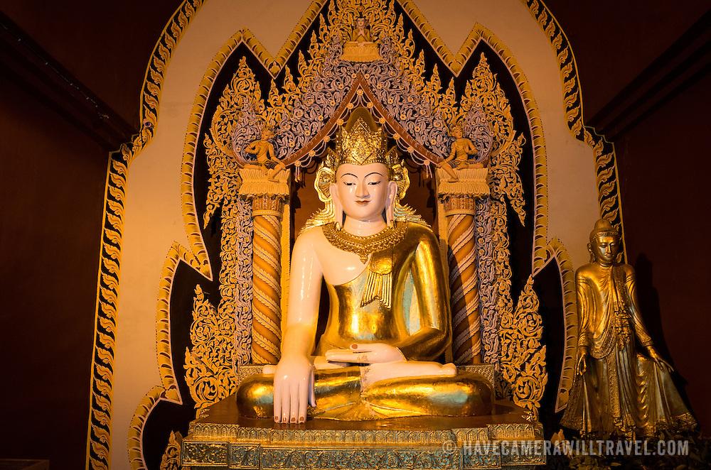 "An ornate Buddha shrine at the Myazedi (or Mya Zedi) Pagoda, in the northern part of Myinkaba Village, just woth of Old Bagan. Myazedi translates as ""emerald stupa."""