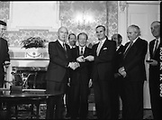 New Fianna Fáil Administration Sworn In.  (R52)..1987..10.03.1987..03.10.1987..10th March 1987..After their win in the recent general election the new Fianna Fáil government,under the leadershio of Charles Haughey, was sworn in and given their seals of offce at a ceremony in Áras an Uachtaráin today. The government received their seals from President Patrick Hillery...Photograph shows President Hillery presenting the seal of office to Michael Noonan at the ceremony in the Arás