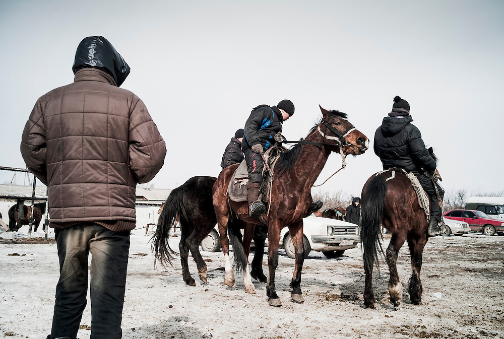 Restless teenagers encourage their horses to jostle in training for playing the national sport of ulak tartysh (horse polo played with the body of a goat). Our western equivalent of this scene would be lads riding BMX in the car park at tesco's.