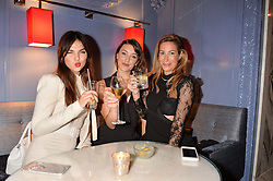LONDON, ENGLAND 8 DECEMBER 2016: Doina Ciobanu, Eleanor Gecks, Laura Pradelska at the Omega Constellation Globemaster Dinner at Marcus, The Berkeley Hotel, Wilton Place, London England. 8 December 2016.