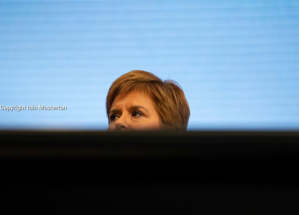 Edinburgh, Scotland, UK. 27 April, 2019. SNP ( Scottish National Party) Spring Conference takes place at the EICC ( Edinburgh International Conference Centre) in Edinburgh. Pictured; First Minister Nicola Sturgeon, partially hidden behind table