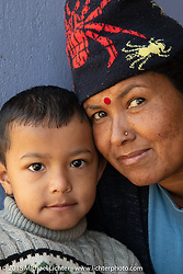 Nepales mother and child during a rest stop on day-4 our our Himalayan Heroes adventure riding from Pokhara to Kalopani, Nepal. Friday, November 9, 2018. Photography ©2018 Michael Lichter.