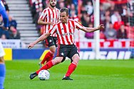 Lee Cattermole of Sunderland (6) passes the ball during the EFL Sky Bet League 1 first leg Play Off match between Sunderland and Portsmouth at the Stadium Of Light, Sunderland, England on 11 May 2019.
