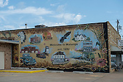 A mural is painted on the side of a building in downtown Watonga.