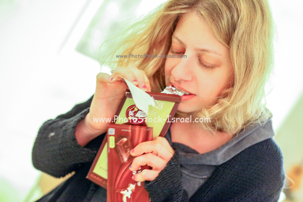 Young woman with a craving for chocolate