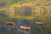 Three rowboats on Agvatnet Lake above Å, Lofoten Islands, Norway.
