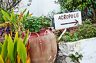 A  hand-painted sign points the way to the Acropolis in Athens, Greece.