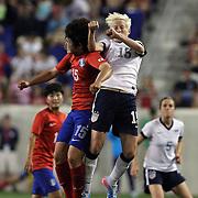Megan Rapinoe, USA, is challenged by Kim Narae, North Korea, during the U.S. Women Vs Korea Republic friendly soccer match at Red Bull Arena, Harrison, New Jersey. USA. 20th June 2013. Photo Tim Clayton