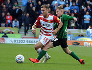 Herie Kane ad Luke Thomas go for the ball during the EFL Sky Bet League 1 match between Doncaster Rovers and Coventry City at the Keepmoat Stadium, Doncaster, England on 4 May 2019.
