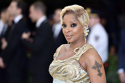 Mary J. Blige walking the red carpet at The Metropolitan Museum of Art Costume Institute Benefit celebrating the opening of Heavenly Bodies : Fashion and the Catholic Imagination held at The Metropolitan Museum of Art  in New York, NY, on May 7, 2018. (Photo by Anthony Behar/Sipa USA)