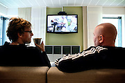 Two inmates are watching a television program in one of the common kitchen and living room areas established to be a meeting point between inmates and guards and to facilitate rehabilitation inside the luxurious Halden Fengsel, (prison) near Oslo, Norway.
