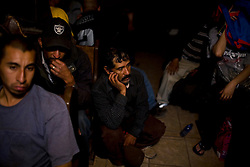 Men who were detained by US Border Patrol and returned to Mexico after a failed attempt to cross the border waitto be admitted to a shelter.  These men have little or no money and will spend the night in Nogales while they decide whether to return home or make another attempt at crossing.