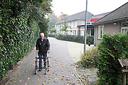 elderly man walking with a walker