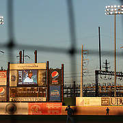 The Bridgeport Harbor Power Station and train line provides a back drop to the ballpark during the Bridgeport Bluefish V Southern Maryland Blue Crabs, Atlantic League, Minor League ballgame at Harbor Yard Ballpark, Bridgeport, Connecticut, USA. Photo Tim Clayton
