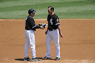 CHICAGO - JULY 09:  Third base coach Jeff Cox #8 talks to Paul Konerko #14 of the Chicago White Sox during the game against the Cleveland Indians on July 9, 2009 at U.S. Cellular Field in Chicago, Illinois.  The Indians defeated the White Sox 10-8.  (Photo by Ron Vesely)