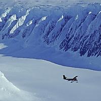 ANTARCTICA. Twin Otter ski plane flies over Calley Glacier, Antarctic Peninsula. Detroit Plateau bkg.