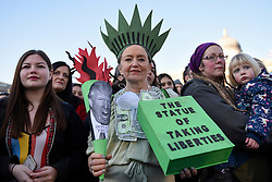 © Licensed to London News Pictures. 21/01/2017. London, UK. A woman dressed as The Statue of Liberty is one of the tens of thousands of women taking part in the Women's March in central London.  The event, alongside others taking place worldwide, is a protest against gender inequality. Photo credit : Stephen Chung/LNP