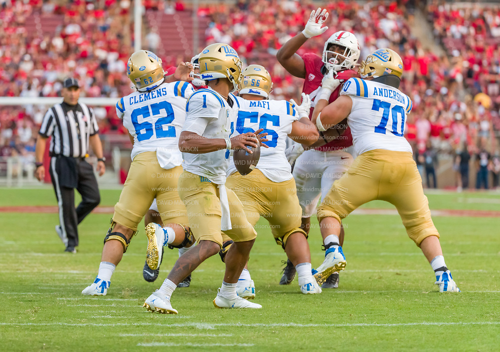 PALO ALTO, CA - SEPTEMBER 26:  Dorian Thompson-Richardson #1 of the UCLA Bruins plays in an NCAA Pac-12 college football game against the Stanford Cardinal on September 26, 2021 at Stanford Stadium in Palo Alto, California; blocking are Duke Clemens #62, Atonio Mafi #56, and Alec Anderson #70 of the Bruins; defending is Thomas Booker #4 of Stanford.  (Photo by David Madison/Getty Images)