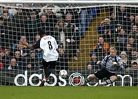 Photo. Glyn Thomas.<br /> Fulham v Southampton. FA Barclaycard Premiership. <br /> Loftus Road, London. 26/12/2003.<br /> Fulham's Louis Saha (L) slots his second half penalty past the diving Antti Niemi to give his side a 2-0 win.