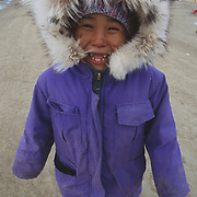 An Inuit child playing in the town of Igloolik, Canada.
