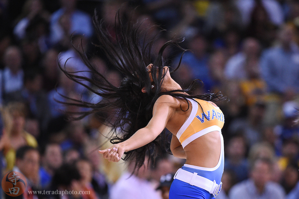 November 5, 2014; Oakland, CA, USA; Golden State Warriors Dance Team dancer Angel Herrera performs during the second quarter against the Los Angeles Clippers at Oracle Arena. The Warriors defeated the Clippers 121-104.