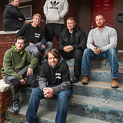 From left, Jessie Ghee, Steven Kelly, Connor Zajac, house manager Mike White (top), Shaun Bass, and co-founders Arron Walker and Jason Dillard pose for a group photo on the front steps of the Spartan House in Charleston, W.Va., on Friday, March 22, 2019.