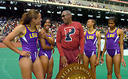 Bill Cosby (center) chats with the winning LSU women's shuttle hurdle relay (from left) Lolo Jones, RaNysha LeBlanc, Tiffany Robinson and Brittany Littlejohn in the 110th Penn Relays at  Franklin Field on Friday, April 23, 2004 in Philadelphia.