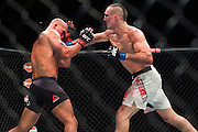 Rory MacDonald fights against Robbie Lawler during UFC 189 at the MGM Grand Garden Arena in Las Vegas, Nevada on July 11, 2015. (Cooper Neill)