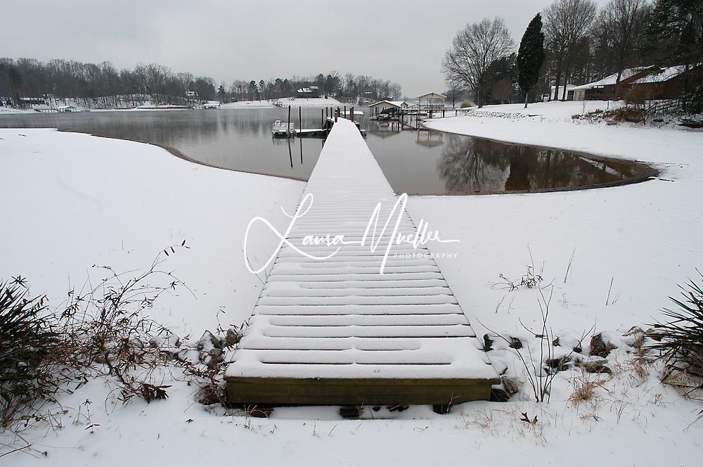 Snow covers the dock after a light snowfall on Lake Norman near Mooresville, NC. photo © Laura Mueller 2004