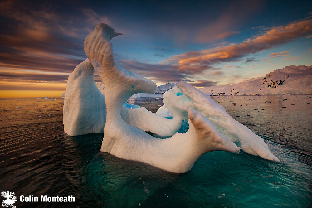 Iceberg with thin arch at sunset, Cierva Cove, Antarctic Peninsula