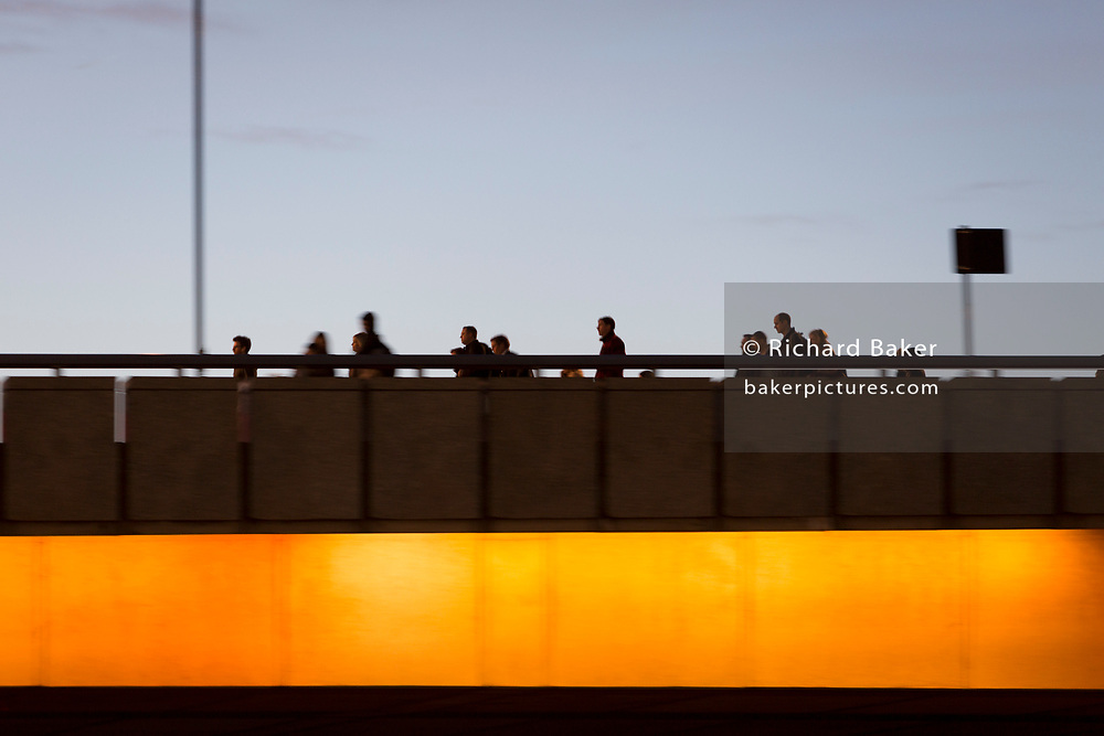 Evening rush-hour commuters cross London Bridge after the beginning of winter time, on 29th October 2018, in London, England.