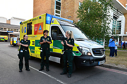 Ambulance workers clapping support at Thursday 8pm clap for carers during Coronavirus lockdown, Royal Berkshire Hospital UK May 2020