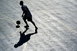 © London News Pictures. 23/09/2013 . Brighton, UK.   A man takes part in a game of basketball in bright sunlight on Brighton seafront, where the Labour Party Conference is currently taking place. . Photo credit : Ben Cawthra/LNP