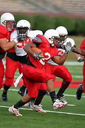 18 AUG 2007: Rafael Rice runs right. The Illinois State Redbirds, ranked in the top 10 in pre-season polls, prepare for the beginning of the season during the annual Red/White inter-squad scrimmage on the newly installed turf at Hancock stadium in Normal Illinois.