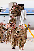 """15 JANUARY 2012 - PHOENIX, AZ:    Returning soldiers file off an airplane at the The 161st Air Refueling Wing of the Arizona Air National Guard in Phoenix. About 100 soldiers of A (Alpha) Company of the 422nd Expeditionary Signal Battalion (referred to as """"Alpha 4-2-2"""") of the Arizona Army National Guard returned to Arizona on Sunday, Jan. 15, following a nearly year-long deployment to Afghanistan. More than 10,000 Arizona Army and Air National Guard Soldiers and Airmen have been ordered to federal active duty in support of Operations Noble Eagle, Enduring Freedom, Iraqi Freedom, and New Dawn since September 2001. Approximately 200 Arizona National Guard Soldiers and Airmen are still serving on federal active duty overseas.  PHOTO BY JACK KURTZ"""