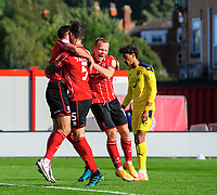 Lincoln City's Adam Jackson, centre, celebrates scoring his side's second goal with team-mates Tom Hopper, left, and Anthony Scully<br /> <br /> Photographer Chris Vaughan/CameraSport<br /> <br /> The EFL Sky Bet League One - Saturday 12th September 2020 - Lincoln City v Oxford United - LNER Stadium - Lincoln<br /> <br /> World Copyright © 2020 CameraSport. All rights reserved. 43 Linden Ave. Countesthorpe. Leicester. England. LE8 5PG - Tel: +44 (0) 116 277 4147 - admin@camerasport.com - www.camerasport.com - Lincoln City v Oxford United