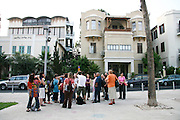 Israel, Tel Aviv Filming in Rothschild boulevard a group admiring the Bauhaus architecture